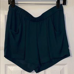 Green BCBG shorts.